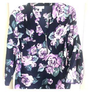 Jaclyn Smith. Flower print blouse.